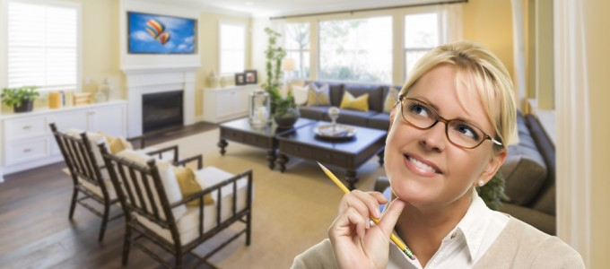 Attractive Daydreaming Woman with Pencil Inside Beautiful Living Room.
